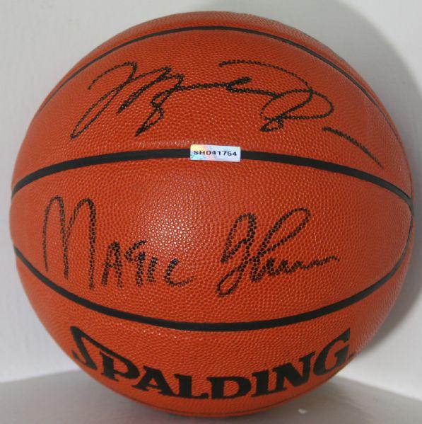 b3b10011ab2 Michael Jordan   Magic Johnson Dual Signed Spalding NBA Leather Game Model  Basketball (UDA) ...