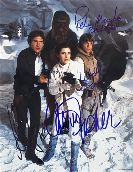The Empire Strikes Back: Harrison Ford, Mark Hamill, Carrie Fisher & Peter Mayhew Cast Signed 8 x 10 Photo (Beckett/BAS LOA)